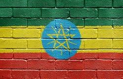 Vlag van Ethiopië op bakstenen muur Stock Fotografie