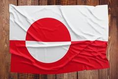 Vlag van Groenland op een houten lijstachtergrond Gerimpelde vlag hoogste mening stock fotografie