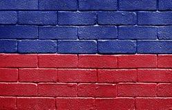 Vlag van Haïti op bakstenen muur royalty-vrije stock foto