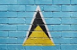 Vlag van Heilige Lucia op bakstenen muur stock foto