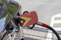 Vlag van het Oosten van Timor op de de vullerklep van de auto` s brandstof stock afbeelding