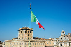 Vlag van Italië over stad van Rome Stock Foto's