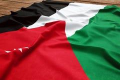 Vlag van Jordani? op een houten bureauachtergrond Hoogste mening van de zijde Jordanian vlag stock foto's