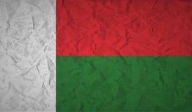 Vlag van Madagascar met het effect van verfrommeld document en grunge stock illustratie