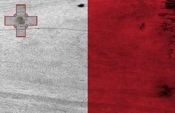 Vlag van Malta op houten plaatachtergrond Textuur van de Grunge de Maltese vlag royalty-vrije stock foto