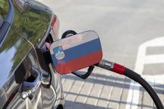 Vlag van op de de vullerklep van de auto` s brandstof royalty-vrije stock foto