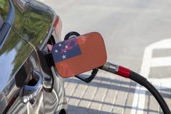 Vlag van Westelijk Samoa op de de vullerklep van de auto` s brandstof royalty-vrije stock afbeelding