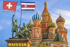 Vlaggen die van Korea Zwitserland en Costa Rica door twee strijders op een standbeeld worden gehouden royalty-vrije stock fotografie