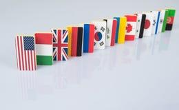 Vlaggen op witte oppervlakte Stock Foto's