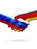 Vlaggen Rusland, de landen van Duitsland, de handdrukconcept van de vennootschapvriendschap Royalty-vrije Stock Foto's