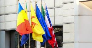 Vlaggen van de Europese Unie van Roemenië, van Italië, van Verenigde Staten en stock videobeelden