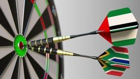 Vlaggen van de V.A.E en Zuid-Afrika op pijltjes die bullseye van het doel raken Internationale samenwerking of de concurrentie vector illustratie