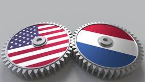 Vlaggen van de V.S. en Nederland bij het inschakelen van toestellen Het internationale samenwerking conceptuele 3D teruggeven Stock Afbeelding