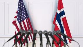 Vlaggen van de V.S. en Noorwegen op internationale bijeenkomst of conferentie het 3d teruggeven Stock Fotografie