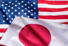 Vlaggen van de vlag van de Verenigde Staten van Amerika en van Japan samen royalty-vrije stock afbeelding