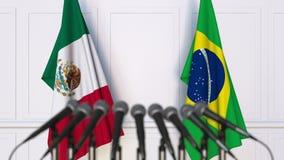 Vlaggen van Mexico en Brazilië op internationale bijeenkomst of conferentie het 3d teruggeven royalty-vrije illustratie