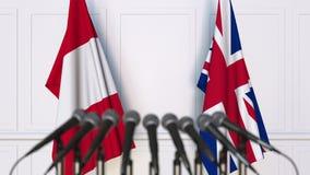 Vlaggen van Peru en het Verenigd Koninkrijk op internationale bijeenkomst of conferentie het 3d teruggeven Stock Afbeeldingen
