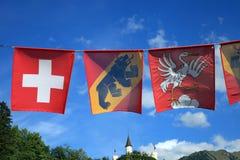 Vlaggen van Zwitserland Stock Foto's