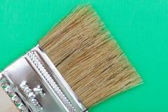 Vlak die Chip Painting Brush op groen wordt ge?soleerd royalty-vrije stock fotografie