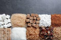 Vlak leg samenstelling met verschillende types van suiker Stock Foto
