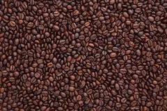 Vlak leg van bruine geroosterde koffieboon kan als backgroun worden gebruikt Royalty-vrije Stock Foto's