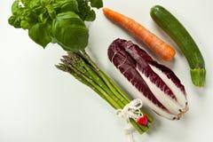 Vlak leg van groen en oranje groenten Royalty-vrije Stock Afbeeldingen