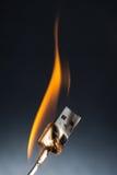 Vlam bij USB-kabel Stock Foto's