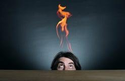 Vlammen en mens Stock Afbeeldingen