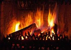 Vlammen in open haard Stock Foto's