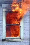 Vlammen in venster Stock Afbeeldingen