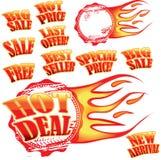 Vlammende verkoopstickers en rubberzegel Stock Afbeelding