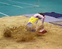 Vlasov Mihailo en la triple salto Fotografía de archivo libre de regalías