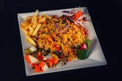 Vlees en gele rijst en aardappel en voorgerecht Stock Foto's