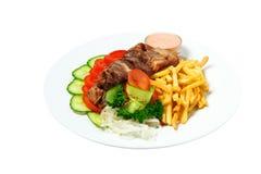 Vlees op een stok met aardappels Royalty-vrije Stock Foto's