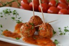 Vleesballetjes in honingstomatensaus Stock Afbeelding