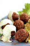 Vleesballetjes met saus stock foto's