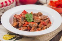 Vleeshutspot met groenten stock afbeelding