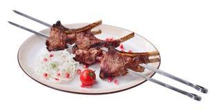 Vleespennen van lam met geïsoleerde beenvleespen, Royalty-vrije Stock Afbeeldingen