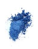Vlek van verpletterde blauwe oogschaduw royalty-vrije stock afbeeldingen