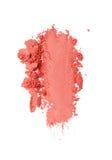 Vlek van verpletterde oranje oogschaduw als steekproef van cosmetische product royalty-vrije stock afbeelding