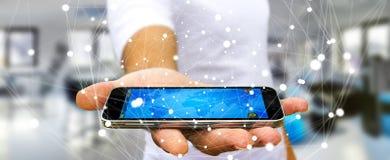 Vliegend het netwerkgebied van de zakenmanholding over zijn mobiele telefoon Royalty-vrije Stock Afbeeldingen