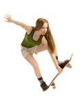 Vliegend meisje -meisje-skateboarder Stock Foto's