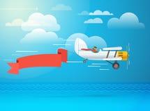 Vliegend uitstekend vliegtuig met de banner Stock Foto