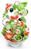 Vliegende groenten - saladeingrediënten. Stock Afbeeldingen