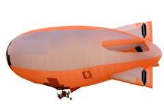 Vliegende oranje blimp Stock Foto