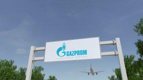 Vliegtuig die over de reclame van aanplakbord met Gazprom-embleem vliegen Het redactie 3D teruggeven Stock Foto