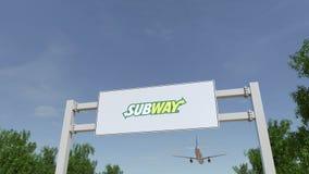 Vliegtuig die over de reclame van aanplakbord met Metroembleem vliegen Het redactie 3D teruggeven Stock Foto's