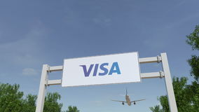 Vliegtuig die over de reclame van aanplakbord met Visa Inc vliegen embleem Het redactie 3D teruggeven Royalty-vrije Stock Afbeeldingen