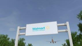 Vliegtuig die over de reclame van aanplakbord met Walmart-embleem vliegen Het redactie 3D teruggeven Royalty-vrije Stock Afbeelding