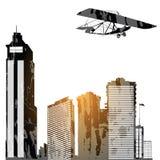 Vliegtuig en skyscrapes Stock Afbeeldingen